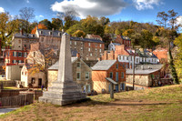John Browns Fort marker with the town of Harpers Ferry in the background