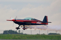 Charlie Schwenker performing a flyby in his Extra 300