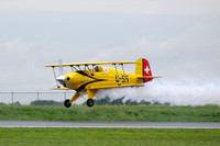 Jerry Wells doing a flyby in his Pitts biplane