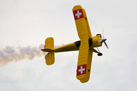 Jerry Wells performing aerobatics in his Pitts biplane.